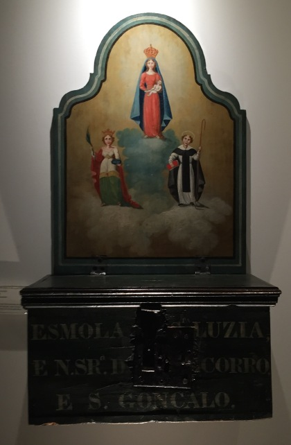 Wooden alms box with paintings of saints