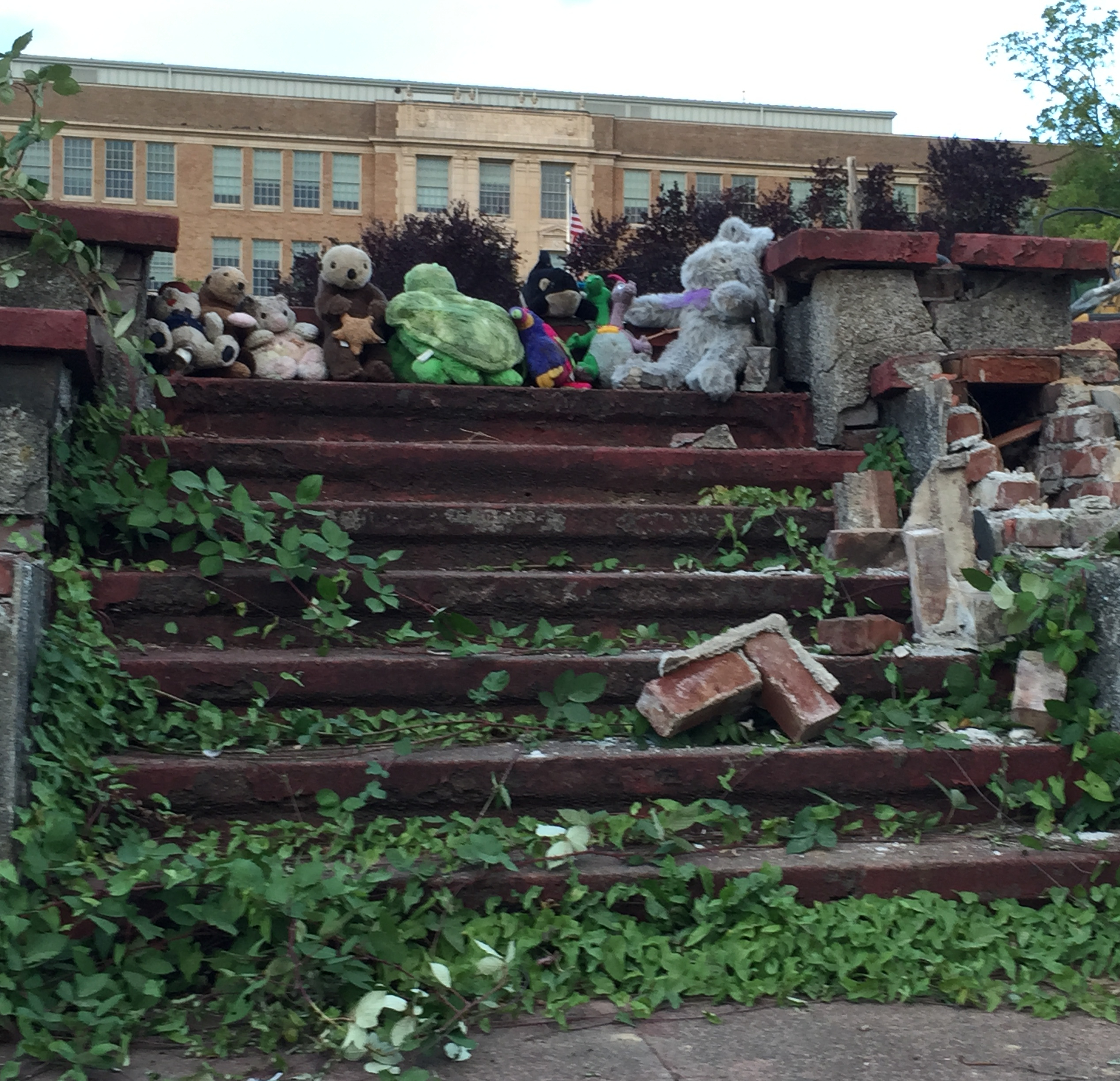 Ruins of building stairs with stuffed animals.